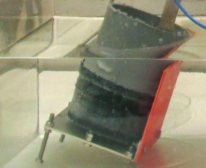 Sample holder with specimen for the rapid chloride migration test